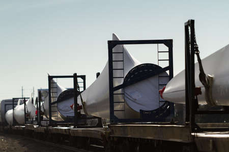 Wind turbine blades waiting to be transported to final location. Editorial