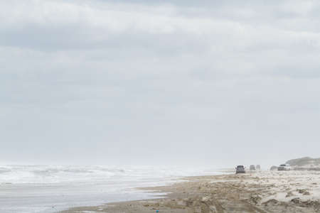 fine particles: Driving on the beach of South Padre Island, TX. Stock Photo