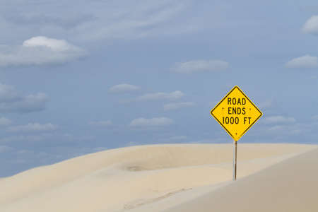 Yellow road sign at the end of the road. Stock Photo - 17179140