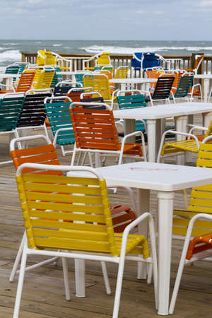 distanation: Empty patio with multi color chair.