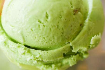 gelati: Green gelato in green plastic cup.