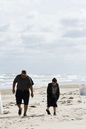 Father and son walking on the beach of South Padre Island, TX. Stock Photo - 17175203