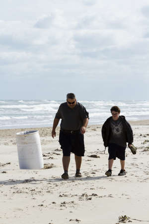 cameron county: Father and son walking on the beach of South Padre Island, TX.