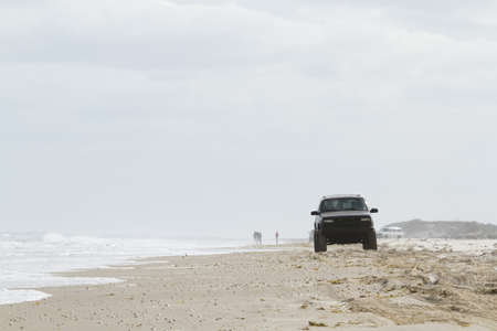 winter road: Driving on the beach of South Padre Island, TX. Editorial
