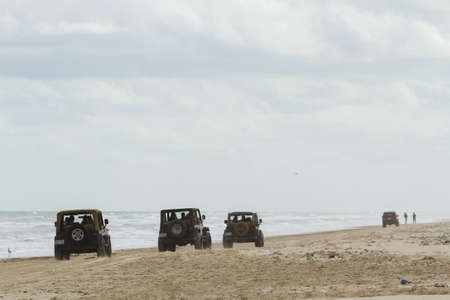 Driving on the beach of South Padre Island, TX. Stock Photo - 17175290