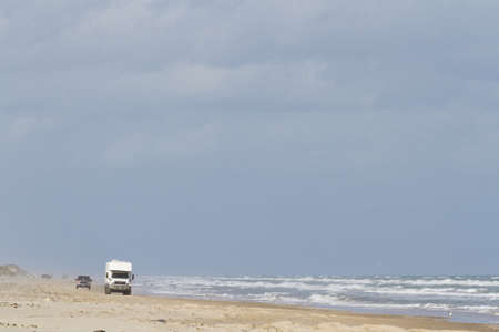 cameron county: Driving on the beach of South Padre Island, TX. Editorial