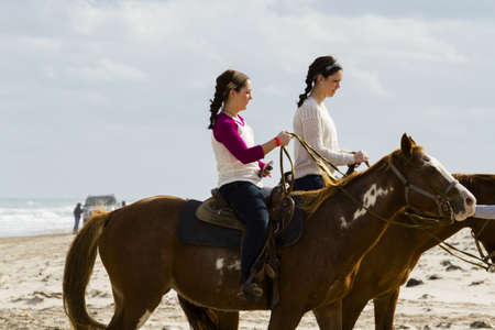 Horeseback riding on the beach of South Padre Island, TX. Stock Photo - 17175267