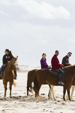 cameron county: Horeseback riding on the beach of South Padre Island, TX. Editorial