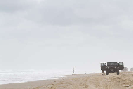 distanation: Driving jeep on the beach of South padre Island, TX. Editorial