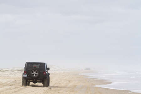 cameron county: Driving jeep on the beach of South padre Island, TX. Editorial
