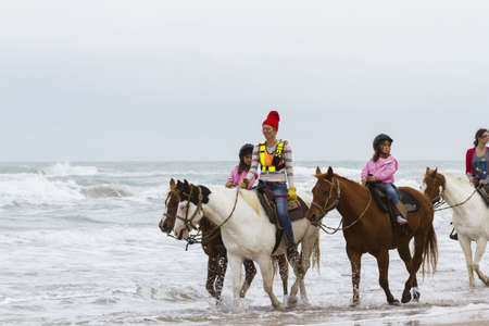 Horeseback riding on the beach of South Padre Island, TX. Stock Photo - 17175285