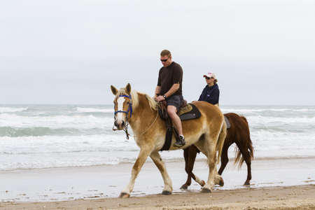 distanation: Horeseback riding on the beach of South Padre Island, TX. Editorial