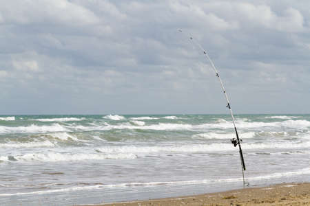 cameron county: Fishing on the beach of South Padre Island, TX.