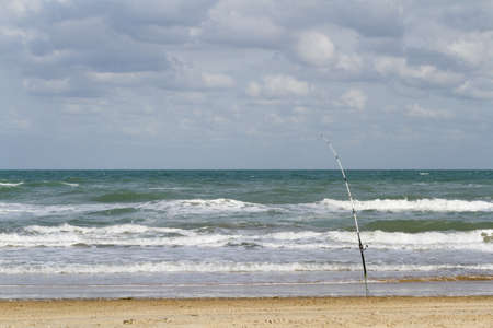 Fishing on the beach of South Padre Island, TX. photo