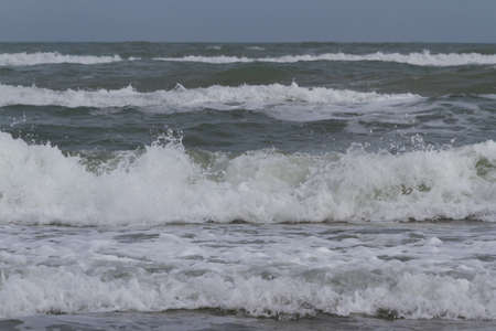 cameron county: Big waves on the ocean.