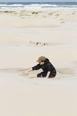 Teenage boy playing on the beach of South Padre Island, TX. photo