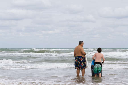 Boogie boarding on South Padre Island, TX. Stock Photo - 17198082