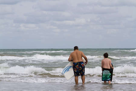 south padre: Boogie boarding on South Padre Island, TX. Stock Photo