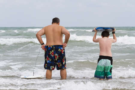 south padre island: Boogie boarding on South Padre Island, TX. Stock Photo