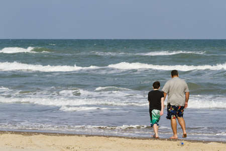 Father and son playing on the beack of South Padre Island, TX. photo