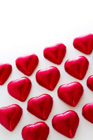 Heart shape chocolate candies on white background. photo