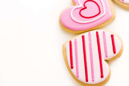 Heart shaped cookies decorated fancy icing patterns. photo