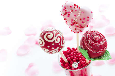 Fancy cake pops decorated for Valentines day. photo