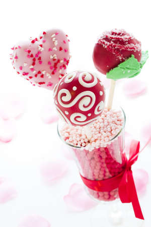baked treat: Fancy cake pops decorated for Valentines day.