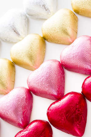 Heart shape chocolate candies wrapped in colorful foil for Valentine's Day. Stock Photo - 17406686