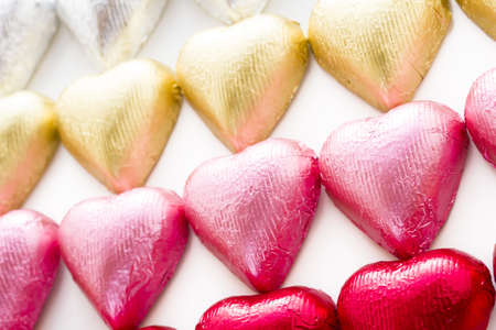 Heart shape chocolate candies wrapped in colorful foil for Valentine's Day. Stock Photo - 17406693