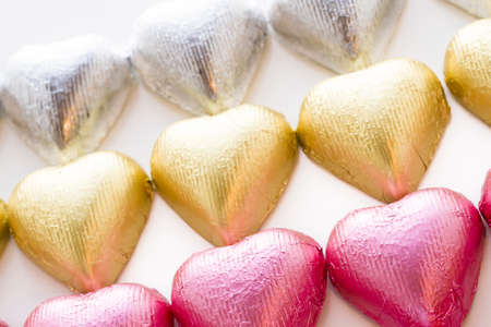 Heart shape chocolate candies wrapped in colorful foil for Valentine's Day. Stock Photo - 17406682