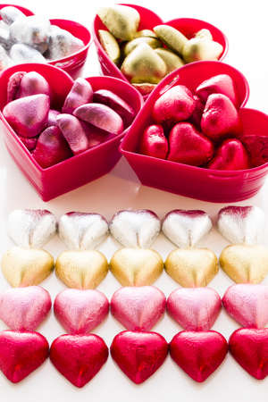Heart shape chocolate candies wrapped in colorful foil for Valentine's Day. Stock Photo - 17406700