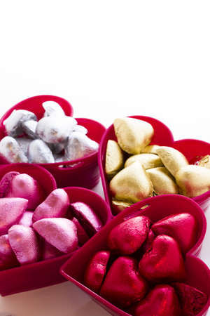 Heart shape chocolate candies wrapped in colorful foil for Valentine's Day. Stock Photo - 17406589
