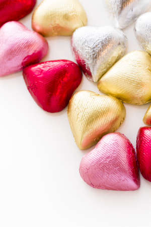 Heart shape chocolate candies wrapped in colorful foil for Valentine's Day. Stock Photo - 17406588
