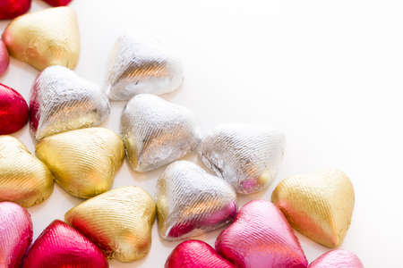 Heart shape chocolate candies wrapped in colorful foil for Valentine's Day. Stock Photo - 17406615