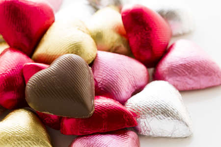 Heart shape chocolate candies wrapped in colorful foil for Valentine's Day. Stock Photo - 17406620