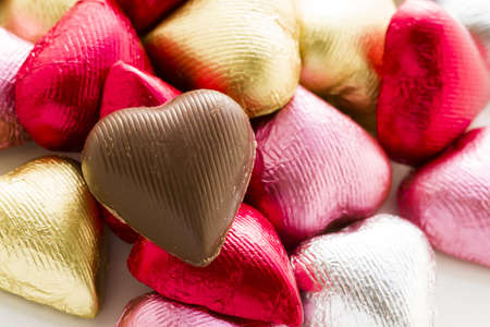 Heart shape chocolate candies wrapped in colorful foil for Valentine's Day. Stock Photo - 17406661