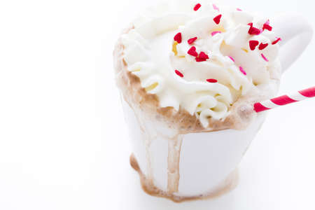Messy hot chocolate with white and red straw. Stock Photo - 17406544