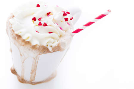 Messy hot chocolate with white and red straw. Stock Photo - 17406525