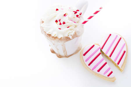 Messy hot chocolate with white and red straw. Stock Photo - 17406522