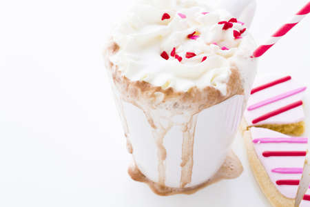 Messy hot chocolate with white and red straw. Stock Photo - 17406543