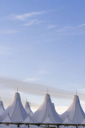 Tents of DIA at sunrise. Denver International Airport well known for peaked roof. Design of roof is reflecting snow-capped mountains. Editorial