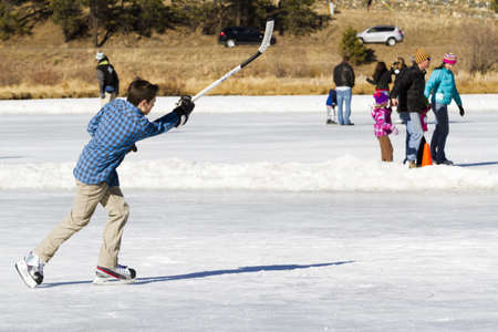 2012-2013 Winter Season. Ice skating on Evergreen Lake, Colorado.