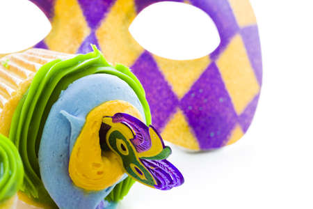 Fancy cupcakes decorated with leaf and mask for Mardi Gras party. Stock Photo - 17489661
