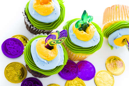 Fancy cupcakes decorated with leaf and mask for Mardi Gras party. Stock Photo - 17489909