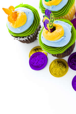 Fancy cupcakes decorated with leaf and mask for Mardi Gras party. Stock Photo - 17489644