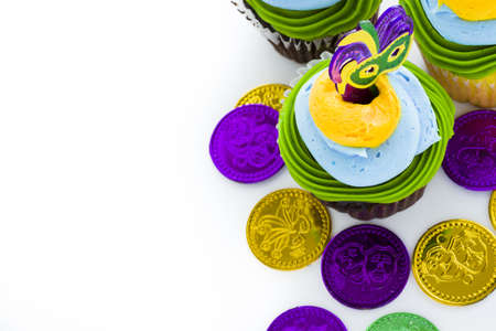 Fancy cupcakes decorated with leaf and mask for Mardi Gras party. Stock Photo - 17489646