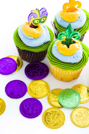 Fancy cupcakes decorated with leaf and mask for Mardi Gras party. Stock Photo - 17489830