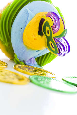 Fancy cupcakes decorated with leaf and mask for Mardi Gras party. Stock Photo - 17489697