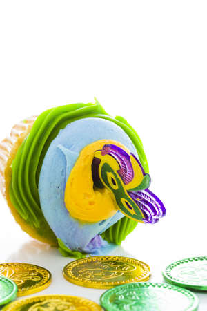 Fancy cupcakes decorated with leaf and mask for Mardi Gras party. Stock Photo - 17489660